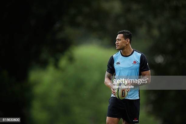 Israel Folau looks on during the Waratahs Super Rugby training session at Kippax Lake on March 15 2016 in Sydney Australia