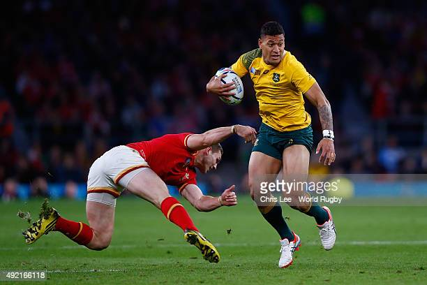 Israel Folau of Australia evades a tackle by George North of Wales during the 2015 Rugby World Cup Pool A match between Australia and Wales at...