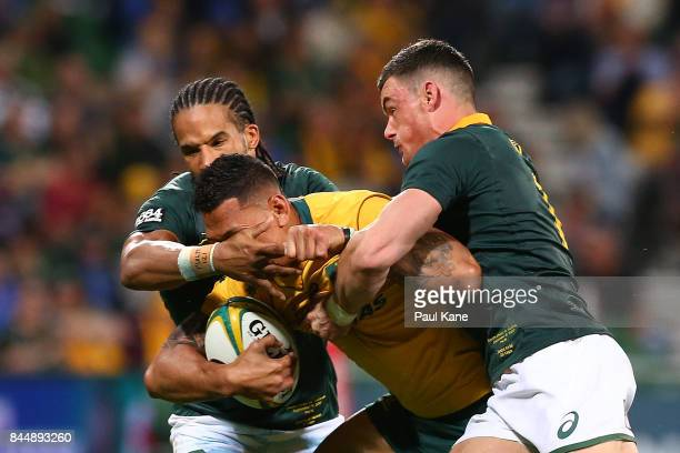 Israel Folau of Australia gets tackled by Courtnall Skosan and Jesse Kriel of South Africa during The Rugby Championship match between the Australian...