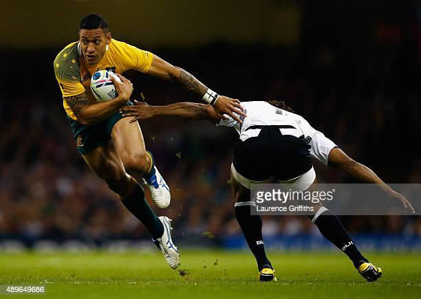 Israel Folau of Australia hands off Metuisela Talebula of Fiji during the 2015 Rugby World Cup Pool A match between Australia and Fiji at the...
