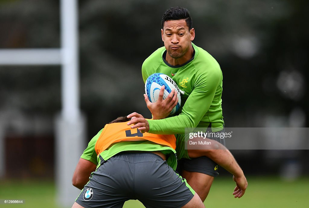 Israel Folau of Australia is tackled by Dane Haylett-Petty of Australia during an Australia training session at The Lensbury Hotel on October 6, 2016 in London, United Kingdom.
