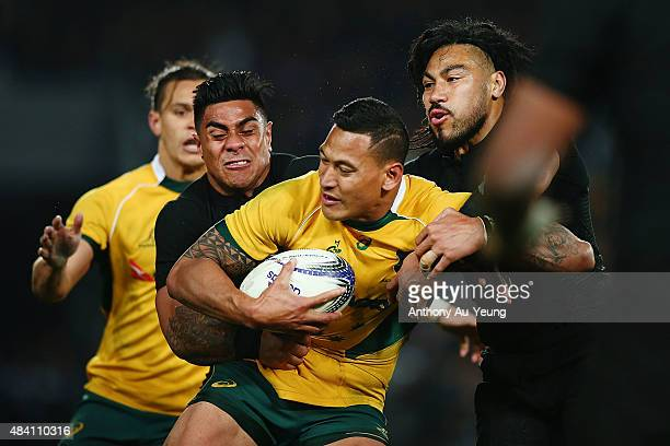 Israel Folau of Australia is tackled by Malakai Fekitoa and Ma'a Nonu of New Zealand during The Rugby Championship Bledisloe Cup match between the...
