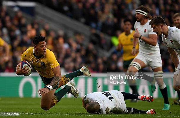 Israel Folau of Australia is tackled by Mike Brown of England during the Old Mutual Wealth Series match between England and Australia at Twickenham...