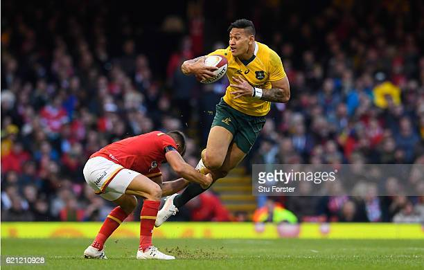 Israel Folau of Australia is tackled by Rhys Webb of Wales during the international match between Wales and Australia at the Principality Stadium on...