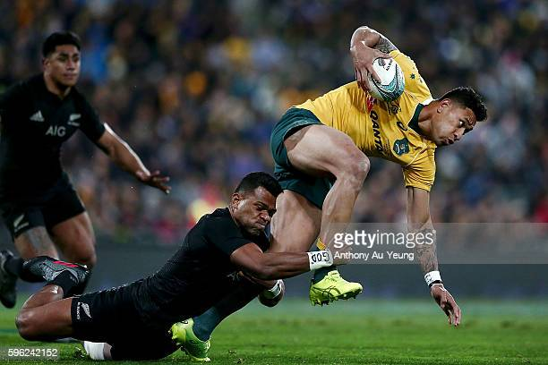 Israel Folau of Australia is tackled by Seta Tamanivalu of New Zealand during the Bledisloe Cup Rugby Championship match between the New Zealand All...