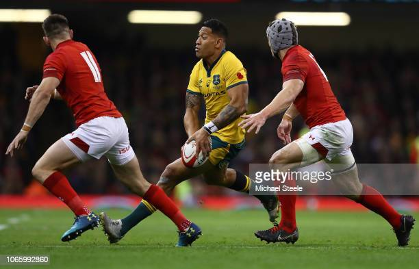 Israel Folau of Australia looks to feed a pass as Dan Lydiate and George North of Wales close in during the International Friendly match between...