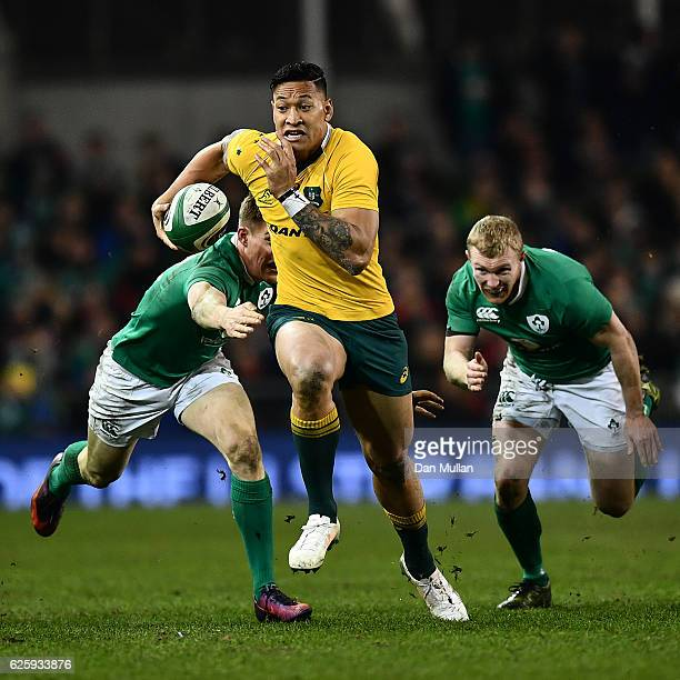 Israel Folau of Australia makes a break past Garry Ringrose of Ireland and Keith Earls of Ireland during the international match between Ireland and...