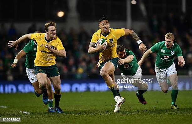 Israel Folau of Australia makes a break past Garry Ringrose of Ireland during the international match between Ireland and Australia at the Aviva...