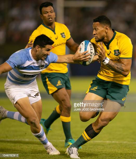 Israel Folau of Australia runs with the ball during an International Rugby Union Championship match against Argentina at the Padre Ernesto Martearena...