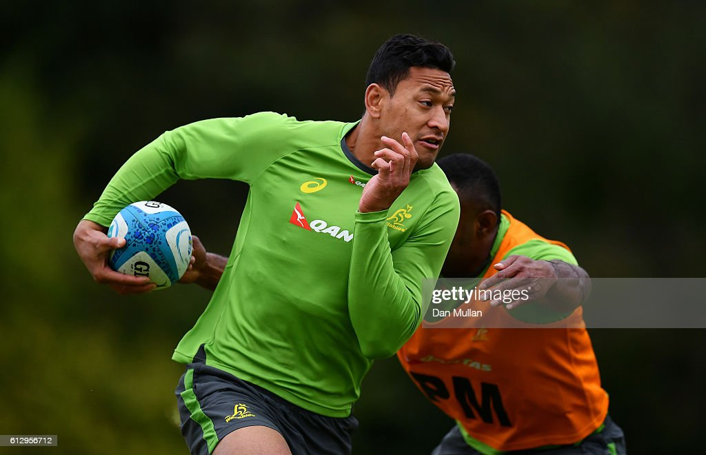 Israel Folau of Australia takes on Tevita Kuridrani of Australia during an Australia training session at The Lensbury Hotel on October 6, 2016 in London, United Kingdom.