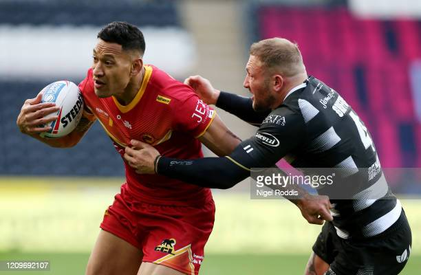 Israel Folau of Catalan Dragons breaks past Josh Griffin of Hull FC during the Betfred Super League match between Hull FC and Catalan Dragons at KCOM...