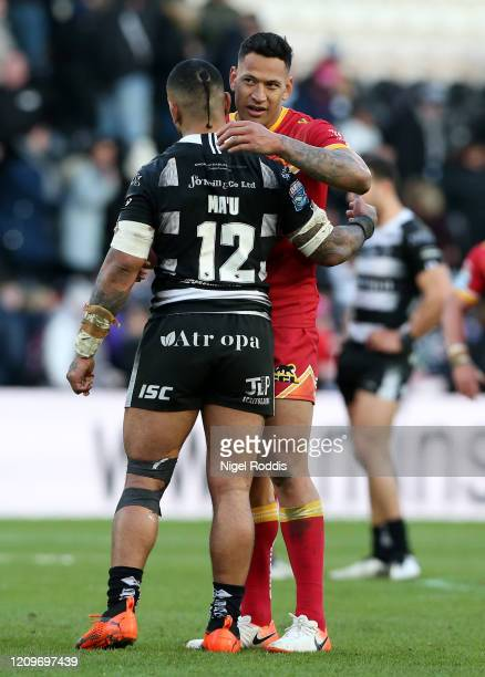 Israel Folau of Catalan Dragons embraces Manu Ma'u of Hull FC after the Betfred Super League match between Hull FC and Catalan Dragons at KCOM...