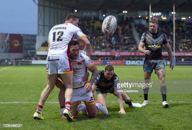 Israel Folau of Catalans Dragons celebrates with teammates after scoring his team's second try during the Betfred Super League match between Catalans...