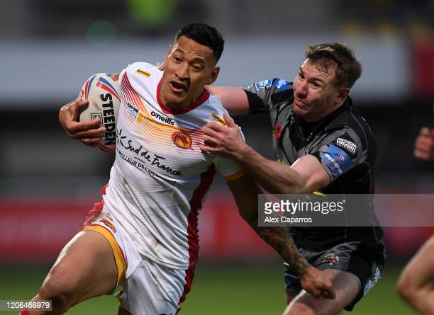 Israel Folau of Catalans Dragons is challenged by Michael Shenton of Castleford Tigers during the Betfred Super League match between Catalans Dragons...