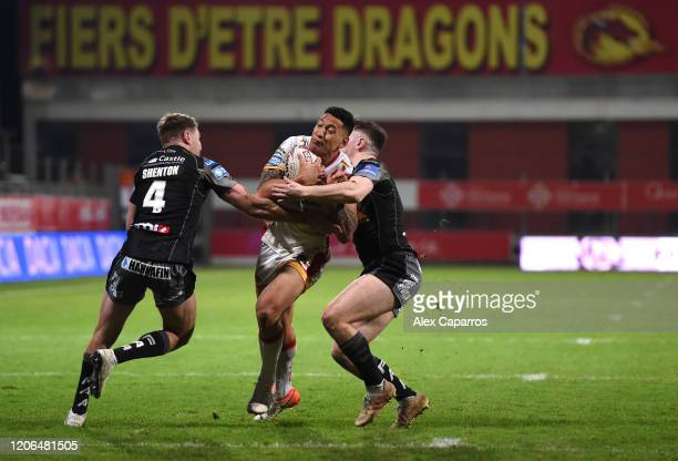Israel Folau of Catalans Dragons is challenged by Michael Shenton of Castleford Tigers and Jake Trueman of Castleford Tigers during the Betfred Super...