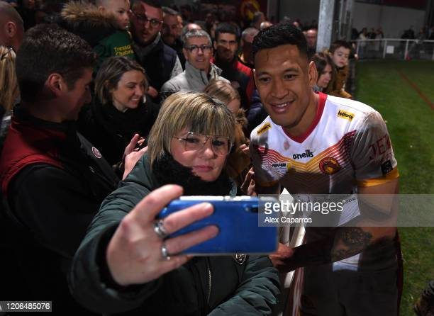 Israel Folau of Catalans Dragons poses for a selfie with a fan following the Betfred Super League match between Catalans Dragons and Castleford...