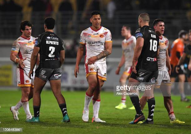 Israel Folau of Catalans Dragons shakes hands with Castleford Tigers players following the Betfred Super League match between Catalans Dragons and...