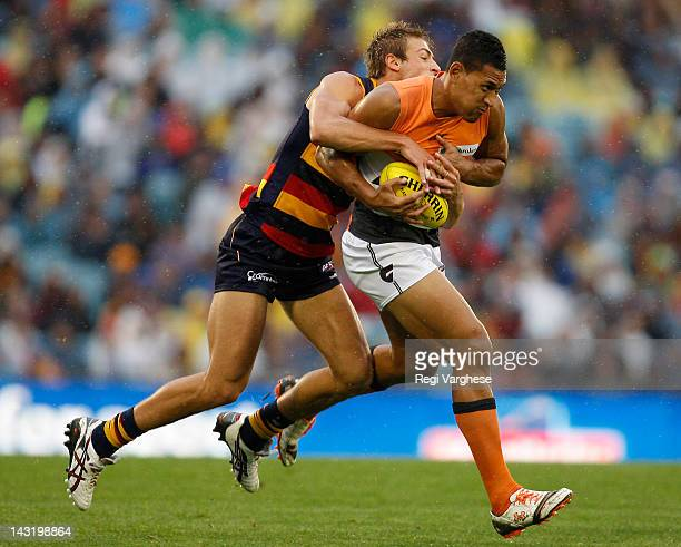 Israel Folau of Greater Western Sydney Giants is tackeld by Daniel Talia of Adelaide Crows during the round four AFL match at AAMI Stadium on April...