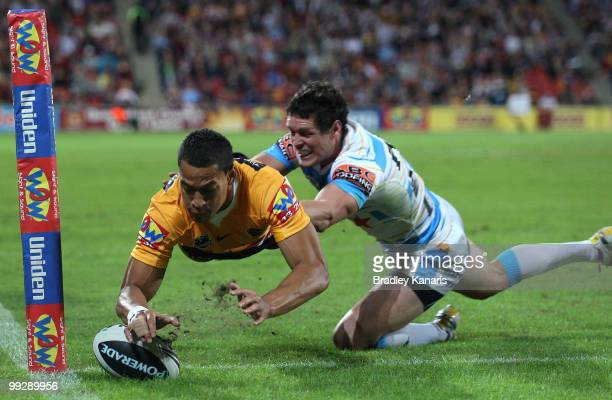Israel Folau of the Broncos scores a try during the round 10 NRL match between the Brisbane Broncos and the Gold Coast Titans at Suncorp Stadium on...