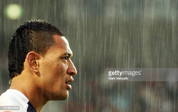 Israel Folau of the Broncos watches a conversion attempt in heavy rain following his second try during the round 13 NRL match between the Manly...
