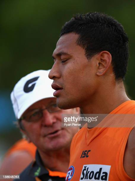 Israel Folau of the Giants is spoken to by Kevin Sheedy, coach of the Giants during the Greater Western Sydney Giants Intra-Club AFL match at...
