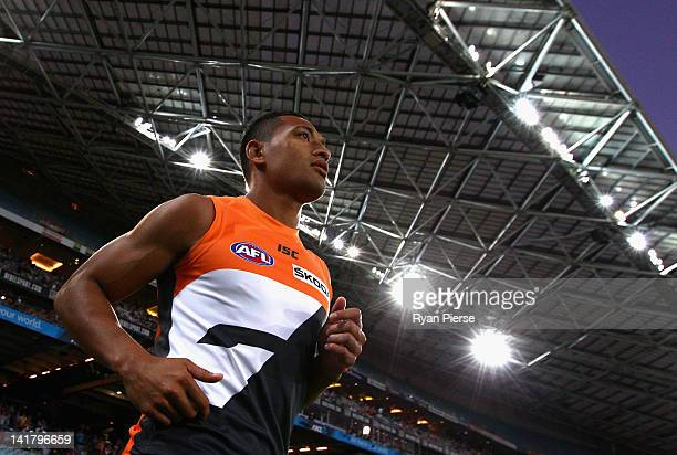 Israel Folau of the Giants runs out onto the field during the round one AFL match between the Greater Western Sydney Giants and the Sydney Swans at...
