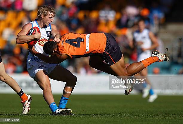 Israel Folau of the Giants tackles Trent McKenzie of the Suns during the round seven AFL match between the Greater Western Sydney Giants and the Gold...