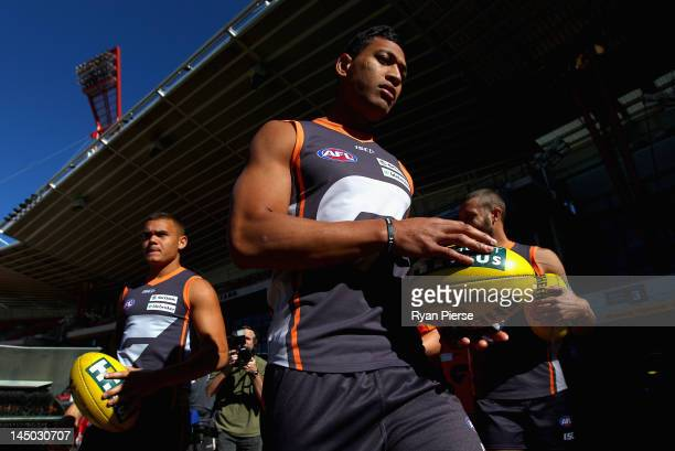 Israel Folau of the Giants warms up at the official opening of SKODA Stadium at Sydney Olympic Park Sports Centre on May 23, 2012 in Sydney,...