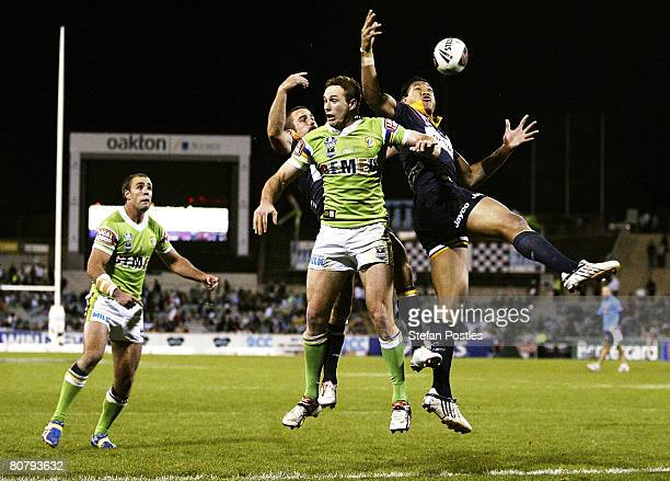 Israel Folau of the Storm jumps for a high ball on his way to scoring a try during the round six NRL match between the Canberra Raiders and the...