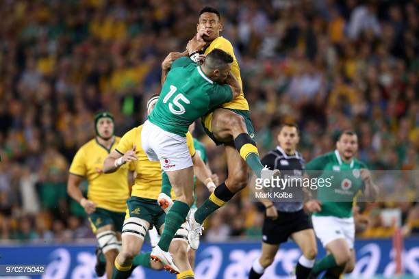Israel Folau of the Wallabies and Rob Kearney of Ireland compete for the ball during the International Test match between the Australian Wallabies...