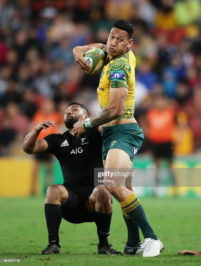 Israel Folau of the Wallabies beats the defence during the Bledisloe Cup match between the Australian Wallabies and the New Zealand All Blacks at Suncorp Stadium on October 21, 2017 in Brisbane, Australia.