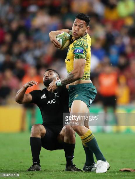 Israel Folau of the Wallabies beats the defence during the Bledisloe Cup match between the Australian Wallabies and the New Zealand All Blacks at...