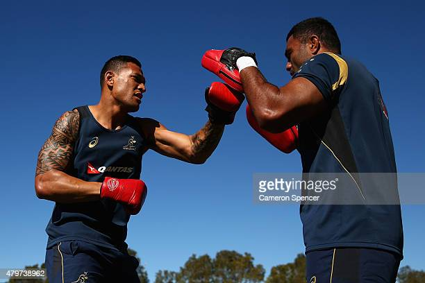 Israel Folau of the Wallabies boxes with Wycliff Palu of the Wallabies during an Australian Wallabies training session at Sunshine Coast Stadium on...