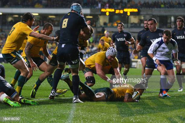 Israel Folau of the Wallabies dives over to score a try during The Rugby Championship match between the Australian Wallabies and Argentina at...