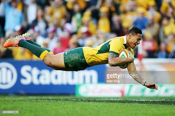 Israel Folau of the Wallabies dives over to score a try during the International Test match between the Australian Wallabies and France at Allianz...