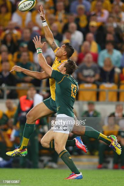 Israel Folau of the Wallabies is tackled by JJ Engelbrecht of the Springboks during The Rugby Championship match between the Australian Wallabies and...