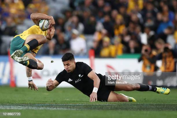 Israel Folau of the Wallabies is tackled by Rieko Ioane of the All Blacks during The Rugby Championship Bledisloe Cup match between the Australian...