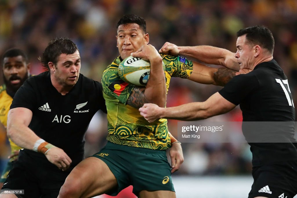 Israel Folau of the Wallabies is tackled by Ryan Crotty of the All Blacks during the Bledisloe Cup match between the Australian Wallabies and the New Zealand All Blacks at Suncorp Stadium on October 21, 2017 in Brisbane, Australia.