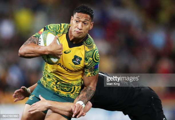 Israel Folau of the Wallabies is tackled during the Bledisloe Cup match between the Australian Wallabies and the New Zealand All Blacks at Suncorp...