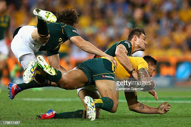 Israel Folau of the Wallabies is tackled during The Rugby Championship match between the Australian Wallabies and the South African Springboks at...