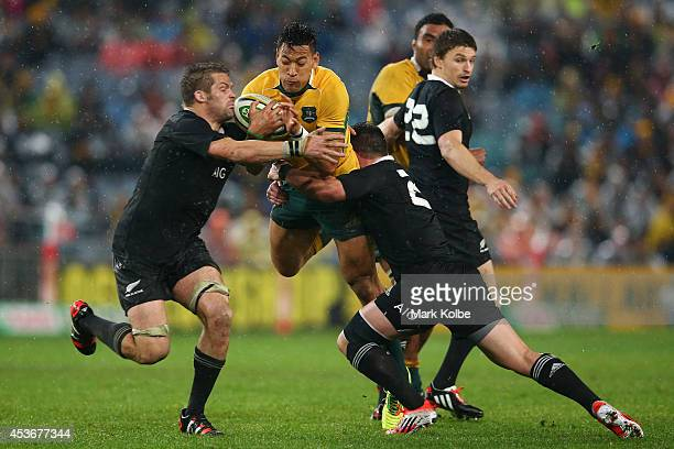 Israel Folau of the Wallabies is tackled during The Rugby Championship match between the Australian Wallabies and the New Zealand All Blacks at ANZ...