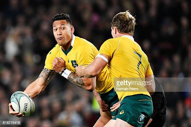 Israel Folau of the Wallabies looks to offload the ball during the Bledisloe Cup Rugby Championship match between the New Zealand All Blacks and the...