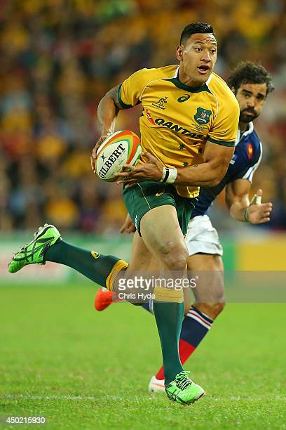 Israel Folau of the Wallabies makes a break during the First International Test Match between the Australian Wallabies and France at Suncorp Stadium...