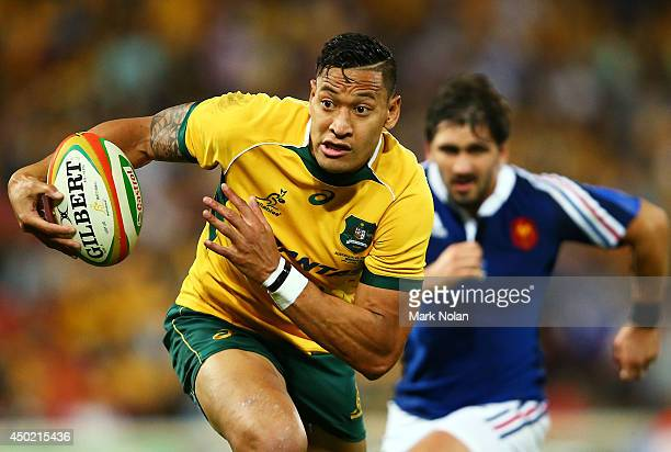 Israel Folau of the Wallabies makes a line break during the First International Test Match between the Australian Wallabies and France at Suncorp...
