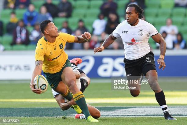 Israel Folau of the Wallabies passes the ball during the International Test match between the Australian Wallabies and Fiji at AAMI Park on June 10...