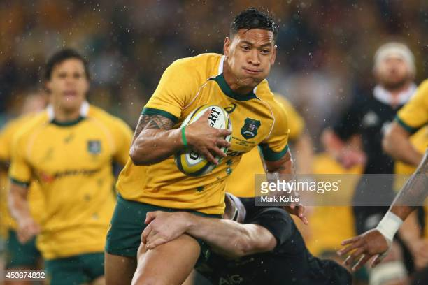 Israel Folau of the Wallabies runs the ball during The Rugby Championship match between the Australian Wallabies and the New Zealand All Blacks at...