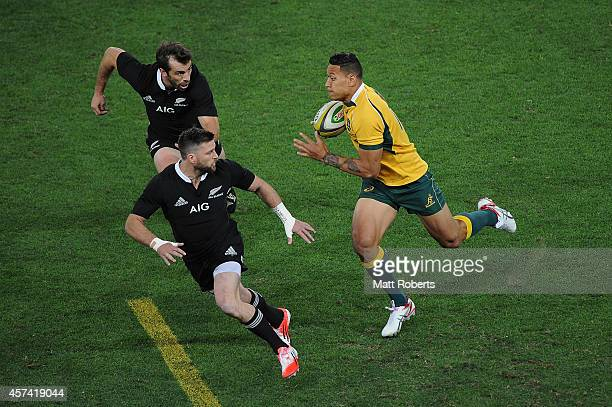 Israel Folau of the Wallabies runs with the ball during The Rugby Championship match between the Australian Wallabies and the New Zealand All Blacks...