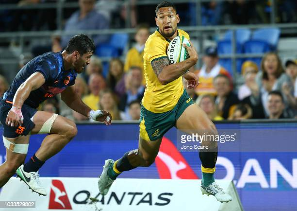 Israel Folau of the Wallabies scores a try in the corner during The Rugby Championship match between the Australian Wallabies and Argentina Pumas at...