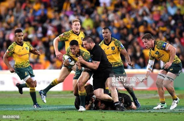 Israel Folau of the Wallabies takes on the defence during the Bledisloe Cup match between the Australian Wallabies and the New Zealand All Blacks at...