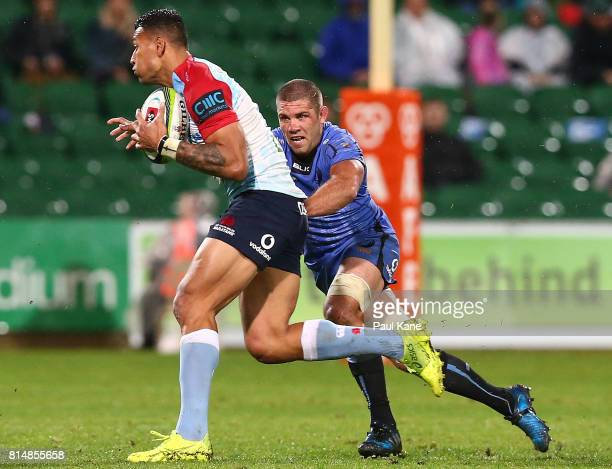 Israel Folau of the Waratahs attempts to break from Matt Hodgson of the Force during the round 17 Super Rugby match between the Force and the...
